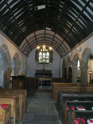 Looking up the nave towards the chancel with a small high east window